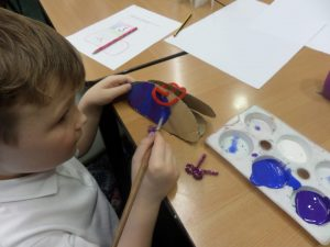 We used paint to decorate our trainers, and used pipe cleaners to act as laces!