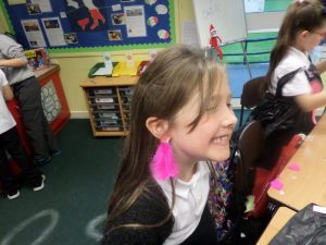 Ellie made sure nothing went to waste - using feathers to make earrings!