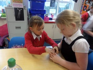 Ou bell only makes a tiny noise because we packed it into a christmas bauble with lots of cotton wool and pom poms.' - Kara and Lacey