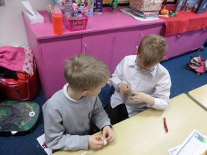 'We put some sparkly pipe cleaners  into the bell to stop it from ringing so much then we put it inside a Christmas bauble. You can still hear it a little bit' - Mason and Finlay