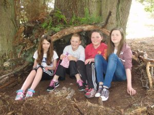 Pleased with their shelter! The Group Leader commented that they were the best shelters he had seen being built and was not going to dismantle them, which he would normally. Well done girls!