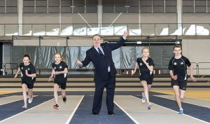 First Minister Alex Salmond with young athletes at the Emirates Arena.