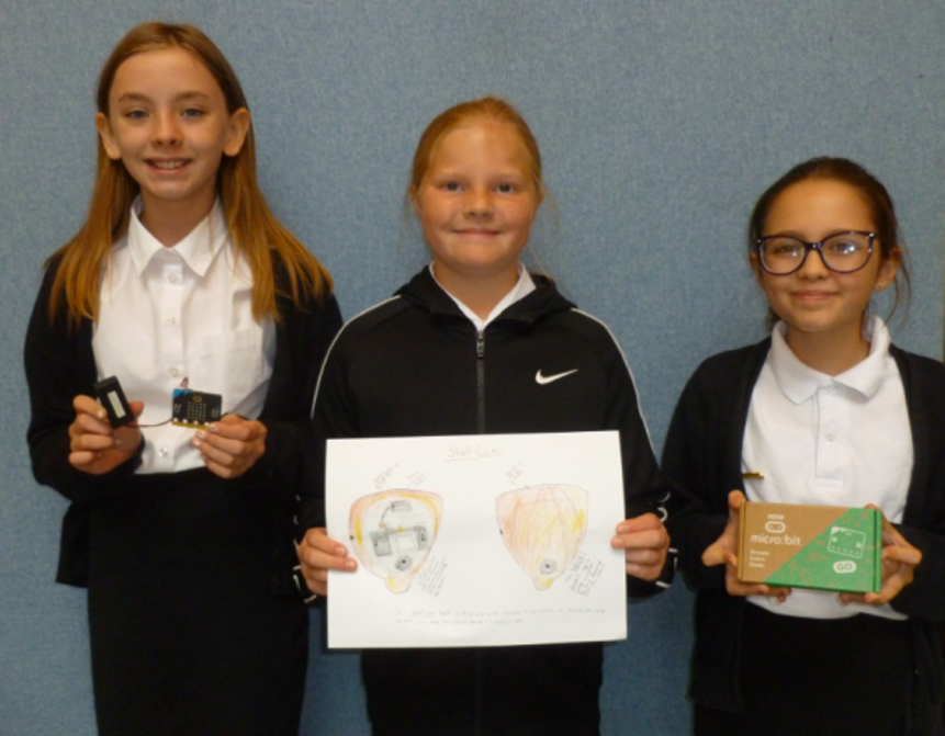 3 learners holding microbits and design for do your bit project