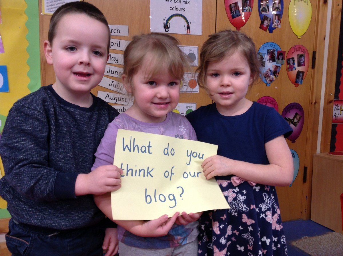 "Pupils holdign sign ""What do you think of this Blog?"""