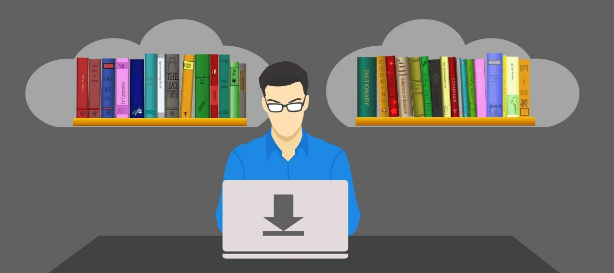 Graphic drawing of a man sitting at a laptop with a shelf of books on either side of him
