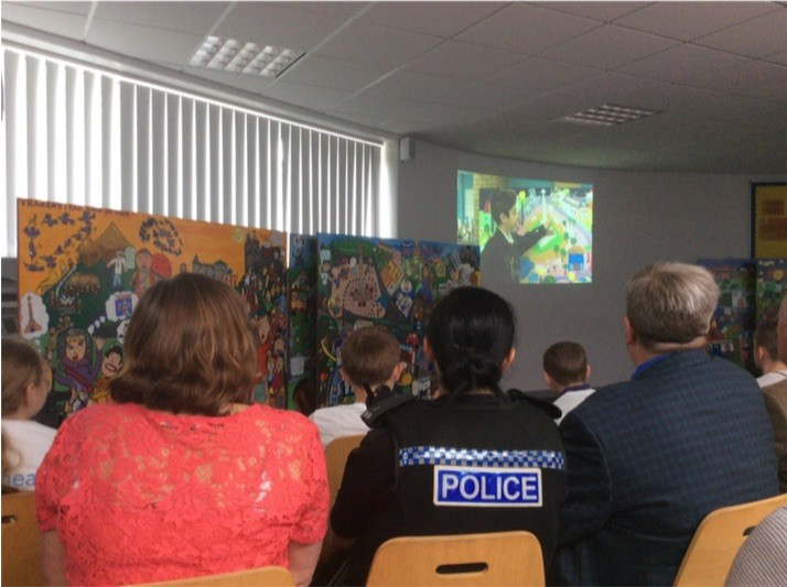 """""""Teachers, Police, Councillors, MP and MSP, Area Partnership officials as well as many other stakeholders were held captive by their confidence in both the live presentation and their video of the construction of the mural which will soon find a permanent home in the Ross High School building where these pupils will eventually attend themselves."""""""