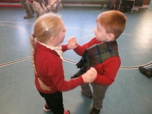 Aria has fun dancing with Alex at Ceilidh Kids.